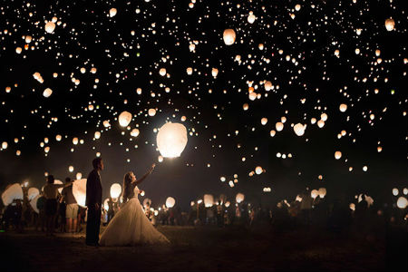 nighttime wedding lantern release