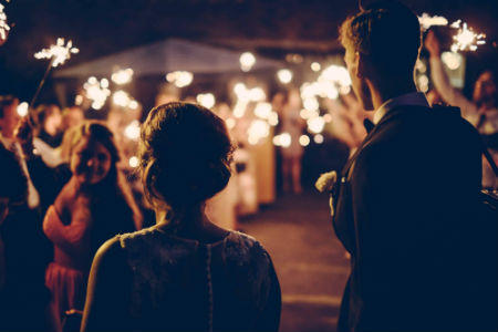 newlyweds exiting wedding with sparklers
